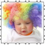 baby wearing clown wig