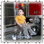 boy sitting on a fire truck