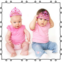 two babies wearing tiaras